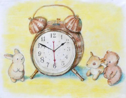 時計を囲う動物たち